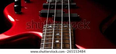 Bass guitar close-up. Photo in low key