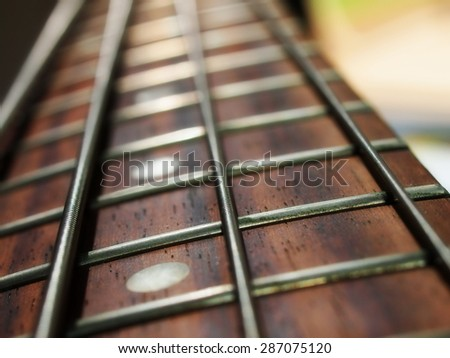 Bass guitar neck and strings - stock photo