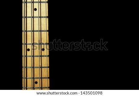 bass guitar neck.black background. close-up.musical instrument - stock photo