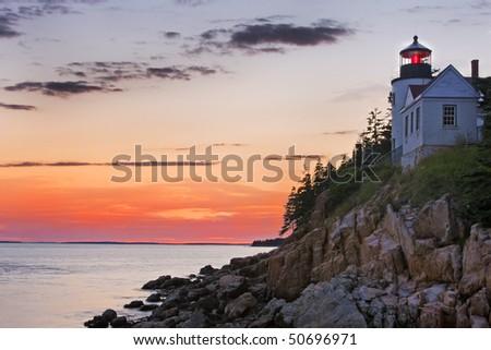 Bass Harbor lighthouse at sunset, Acadia National Park - stock photo