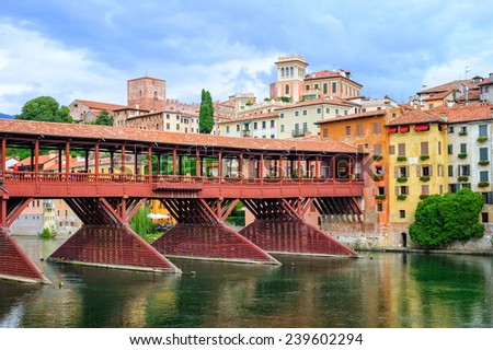 Bassano del Grappa, Veneto, Italy. The town is famous for grappa production. View to the wooden bridge and old grappa distillery. - stock photo