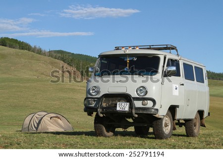 BAT-ULZII, MONGOLIA, July 12, 2013 : Ancient russian trucks are still in use in Mongolian steppes. Half of mongolian population has a nomadic life.