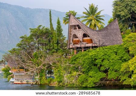 Batak house on the Samosir island near lake Toba, Indonesia, North Sumatra, - stock photo