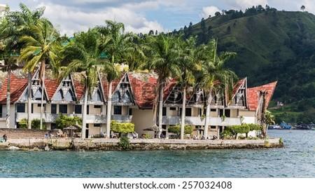 batak houses at samosir island, sumatra, indonesia - stock photo