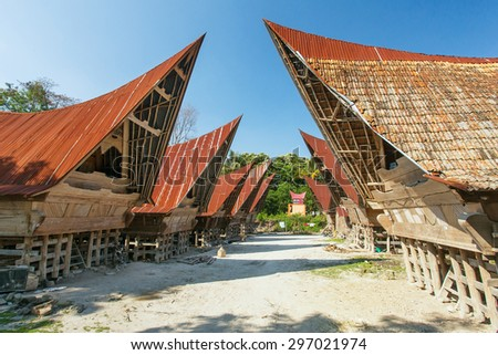 Batak houses on the Samosir island, lake Toba, Indonesia, North Sumatra, - stock photo