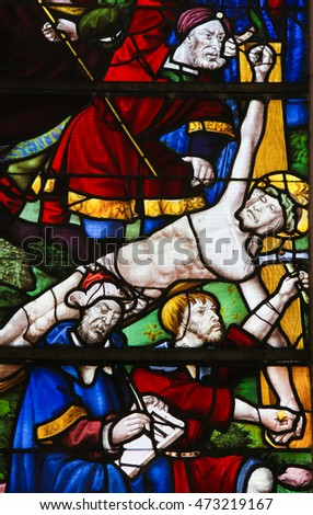 BATALHA, PORTUGAL - JULY 24, 2016: Stained Glass (1508) depicting The Crucifixion of Jesus Christ in the Monastery of Batalha in Portugal.