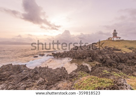Batanes, Philippines-March 28, 2015:Beautiful sunrise at Sabtang Lighthouse located at Sabtang Island in Phillipines. Picture shot during sunny and cloudy day in monsoon season.