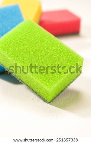 Batch of Kitchen Colorful Sponges Together in line. Placed On White Surface. Vertical Image Composition - stock photo