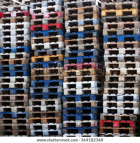 Batch of wooden colourful pallets - stock photo