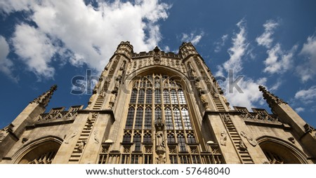 Bath abbey with blue sky and clouds above - stock photo