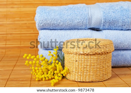 Bath accessories and beauty products on bamboo mat background. Shallow DOF - stock photo