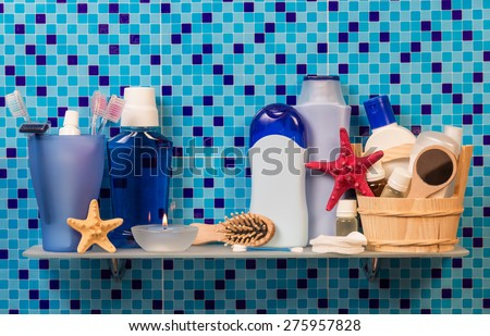 Bath accessories on blue background - stock photo