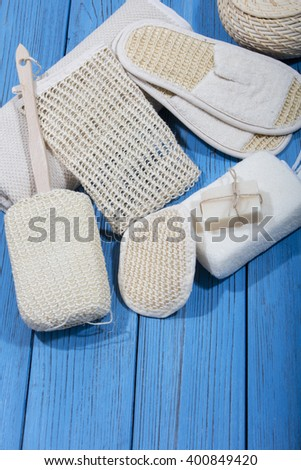 bath and spa accessories on blue wooden background - stock photo