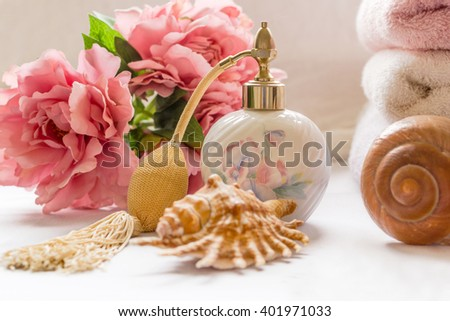 Bath arrangement with parfume bottle and pretty flowers
