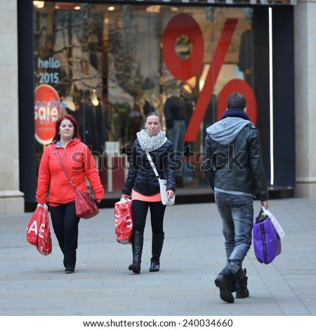 BATH - DEC 26: People visit stores in Southgate shopping district for the Boxing Day Sales on Dec 26, 2014 in Bath, UK. Many stores across the country traditionally hold sales on Boxing Day.    - stock photo