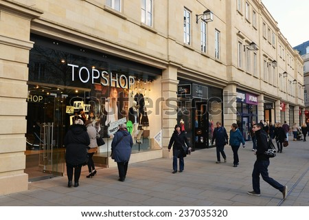 BATH - DEC 8: People walk through Southgate shopping district on Dec 8, 2014 in Bath, UK. The landmark Somerset city is home to many local and international stores and shops. - stock photo