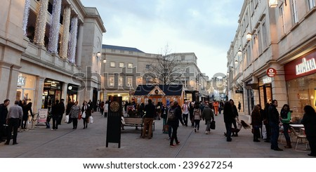 BATH - DEC 8: People walk through Southgate shopping district on Dec 8, 2014 in Bath, UK. The retail traders in the landmark Somerset city have reported busy trade in the run-up to Christmas.  - stock photo