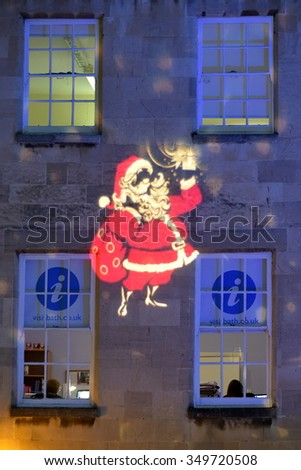 BATH - DEC 9: View of a projected Santa Claus on a building at Christmas Market in the streets surrounding Bath Abbey on Dec 9, 2015 in Bath, UK.