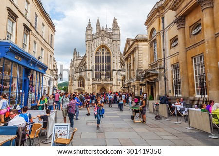 BATH, ENGLAND - JULY 04, 2015: Bath Abbey with unidentified people. It is an Anglican parish church and a former Benedictine monastery, founded in the 7th century - stock photo