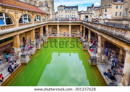 BATH, ENGLAND - JULY 04, 2015: inside of Roman Baths with unidentified people, which is a site of historical interest in the city of Bath. The house is a well-preserved Roman site for public bathing