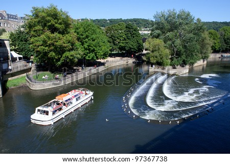 BATH, ENGLAND - JUNE 26: The River Avon, known as the Lower Avon or Bristol Avon, is the 19th longest river in the UK. The weir at Bath regulates the water flow and prevents flood, on June 26, 2011. - stock photo