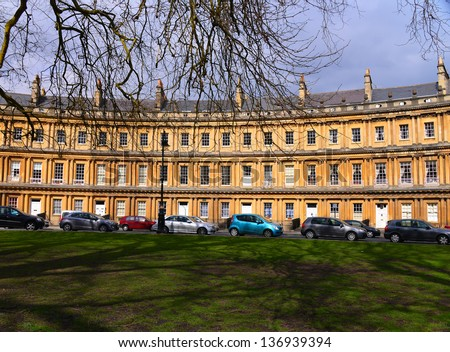 BATH, ENGLAND-MARCH 29: Visitors to Bath are treated to the history and architecture of the Circus on a sunny March 29, 2013. The area around Bath has been occupied since the Roman rule of Britain.