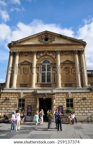 BATH - JUL 26: Tourists and locals enjoy a sunny day in the courtyard of the Roman Baths on Jul 26, 2010 in Bath, UK.  Bath is a UNESCO World Heritage city, with over 4 million visitors per year. - stock photo