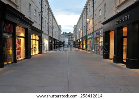 BATH - JUL 26: View of an empty shopping street after evening closing time on Jul 26, 2010 in Bath, UK.  Bath is a famous UNESCO World Heritage status city, with over 4 million visitors per year. - stock photo