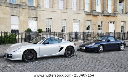 BATH - JUL 26: View of Porsche sports cars parked on the landmark Royal Crescent on Jul 26, 2010 in Bath, UK. Bath is a UNESCO World Heritage city with over 4 million visitors per year. - stock photo