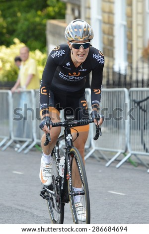 BATH - JUN 11: Dani King rides in the Pearl Izumi Tour Series bicycle race final on Jun 11, 2015 in Bath, UK. The event drew thousands of spectators to the streets of the picturesque Somerset city. - stock photo