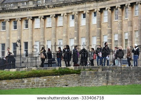 BATH - OCT 20: A tourist group gathers at the landmark Royal Crescent on Oct 20, 2015 in Bath, UK. The Somerset city has UNESCO world Heritage status and receives 4.5 million visitors a year. - stock photo