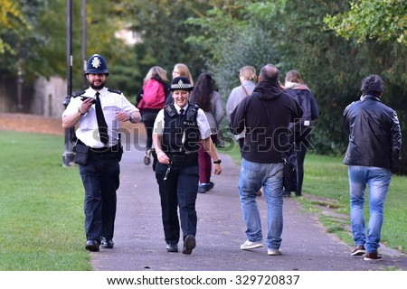 BATH - OCT 20: Police patrol Victoria Park on Oct 20, 2015 in Bath, UK. Despite calls for great protection to police, regular British police officers continue to not carry firearms.