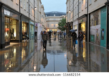 BATH - OCT 5: Shoppers walk through the newly renovated Southgate commercial district on Oct 5, 2012 in Bath, UK. With 37,000 sq metre of retail space Southgate is home to over 50 shops and outlets. - stock photo