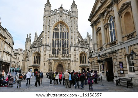 BATH - OCTOBER 4: Tourists and locals walk through the courtyard of the historic Bath Abbey and Roman Baths on October 4, 2012 in Bath, UK. Bath receives approximately 4.5 million visitors a year.