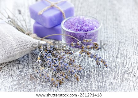 Bath salt for aromatherapy and dried lavender on an old wood table - stock photo