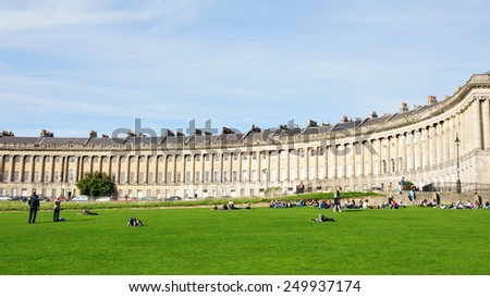 BATH - SEP 20: People gather in Victoria Park below the landmark Royal Crescent on Sep 20, 2010 in Bath, UK. Bath is a UNESCO World Heritage city receiving over 4.5 million visitors per year. - stock photo