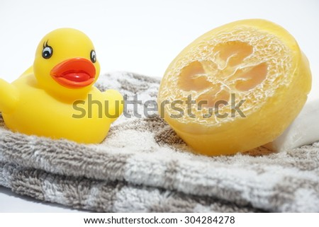 bath time with a rubber ducky and soap - stock photo