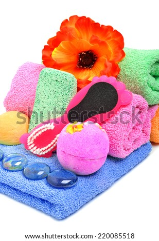 Bath towels, pumice, glass pebble and flower isolated on white - stock photo