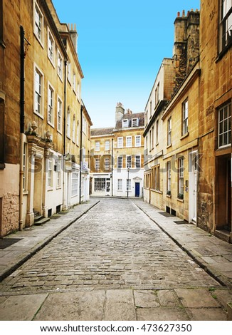 BATH, UK - AUGUST 17, 2016: Georgian street with commercial buildings, Bath. Bath is a city in the ceremonial county of Somerset, England, known for its Roman-built baths