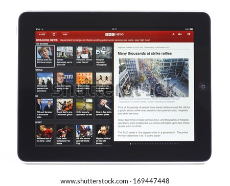BATH, UK - DECEMBER 2, 2011: An Apple iPad displaying the front page of the BBC News App, against a white background. The app can be used to read the latest stories or watch a BBC News live stream. - stock photo