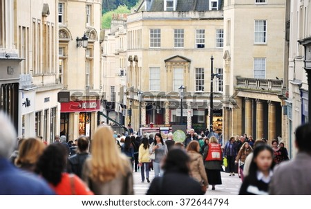 BATH, UK - MAY 1, 2014: People walk along a busy street. The historic Somerset UNESCO World Heritage city is popular travel destination with over 4 million visitors per year. - stock photo