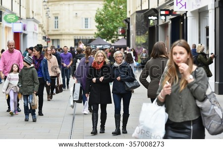 BATH, UK - OCT 18, 2015: People walk on a busy street in Southgate shopping district. The landmark Somerset city has UNESCO World Heritage status and over 4 million visitors a year.