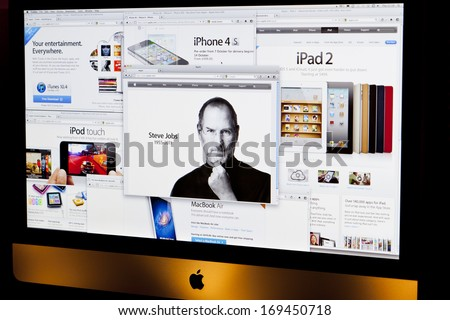 BATH, UK - OCTOBER 6, 2011: An Apple iMac displaying several browser windows relating to Apple products and the front page tribute to former chief executive Steve Jobs, who died on 5th October 2011. - stock photo
