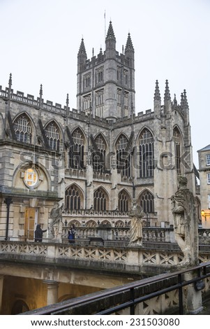 Bath, UK - October 30: Tourists and locals walk through the courtyard of the historic Bath Abbey and Roman Baths on October 30, 2014 in Bath, UK.