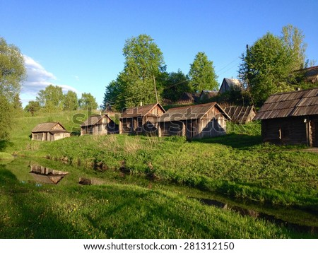 Bathhouses in rural village in Russia, summer country landscape.  - stock photo
