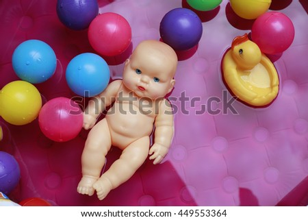 Bathing baby toys and Colored balls - stock photo