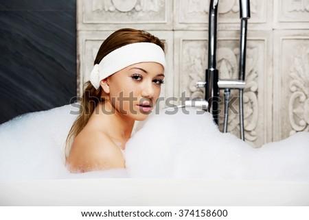 Bathing woman relaxing in bath. - stock photo