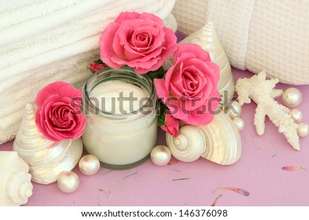 bathroom accessories with pink rose flowers creampearls and sea shells over mottled