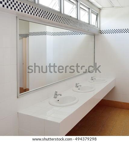 bathroom at officehandbasin and mirror in toilet bathroom office