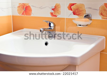 bathroom faucet sink and soap bar